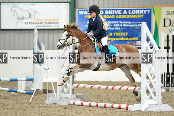 Class 3. Unaffiliated showjumping. Brook Farm Training Centre. Essex. UK. 17/12/2017. ~ MANDATORY CREDIT Garry Bowden/Sport in Pictures - NO UNAUTHORISED USE - +44 7837 394578