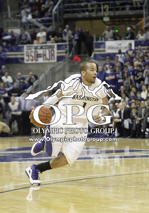 07 March 2009:  Washington guard Venoy Overton brings the ball down court against Washington State at the Bank of America Arena at Hec Edmundson Pavilion in Seattle, WA.  Washington won 67-60 over Washington State and captured the Pac-10 title.