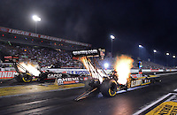 Aug. 31, 2012; Claremont, IN, USA: NHRA top fuel dragster driver Tony Schumacher (right) races alongside Steve Torrence during qualifying for the US Nationals at Lucas Oil Raceway. Mandatory Credit: Mark J. Rebilas-