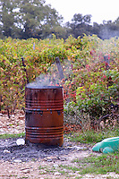 rusty barrel for burning branches domaine montirius vacqueyras rhone france