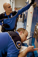 Switzerland. Geneva. Two police officers are asking questions to a prisoner in a cell at the Paquis police station.The inmate is a drug user, who got arrested after trying to enter a shop illegaly and steal articles. The man is a junkie who lives permanently in Geneva and is already well-known by the police for various burglaries and drug affairs. A police station or station house is a building which serves for police officers. The building contains temporary holding cells and interview/interrogation rooms. 29.03.12 © 2012 Didier Ruef..