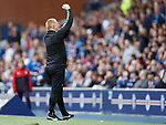 Neil Lennon celebrates and gestures after Hibs score
