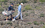 JEJU, SOUTH KOREA - APRIL 23:  Danny Willett of England and his caddie walk over the volcanic rocks on the 9th hole during the fog-delayed Round One of the Ballantine's Championship at Pinx Golf Club on April 23, 2010 in Jeju island, South Korea. Photo by Victor Fraile / The Power of Sport Images
