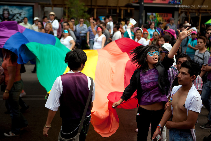 2 June 2012 - Mexico City, Mexico - People hold the rainbow flag and take part in the annual gay pride parade in Mexico City (known in Mexico as Marcha del orgullo LGBTQI). Mexico's high-altitude capital city has a huge and active gay population. The increasingly popular Mexico City Gay Pride is helping to heighten the LGBT community's visibility. The LGBT community has been gaining some rights in the first years of the 21st century. On 2003, the Federal Law to Prevent and Eliminate Discrimination was passed. In November 2006, the Law for Coexistence Partnerships was enacted in the Federal District. On March 2010, Mexico became the first Latin American country to allow same-sex marriage by non-judicial means. Photo credit: Benedicte Desrus