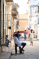 Havana haircut, Cuba -Photo by Meryl Schenker
