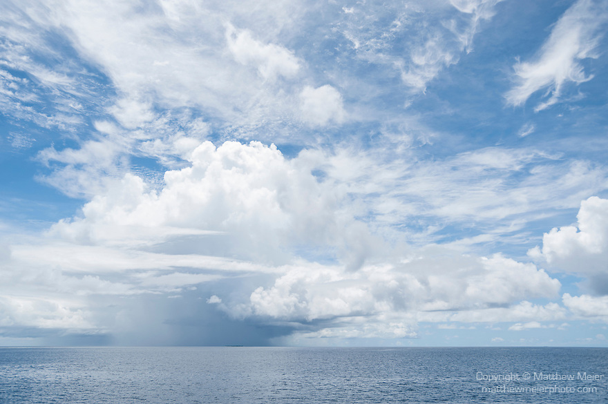 Mahadhdhoo Island, Huvadhoo Atoll, Maldives; storm cloud formations against a blue sky over the Indian Ocean