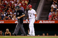 Albert Pujols #5 of the Los Angeles Angels argues with umpire Bill Welke during a game against the Texas Rangers at Angel Stadium on September 20, 2012 in Anaheim, California. Texas defeated Los Angeles 3-1. (Larry Goren/Four Seam Images)