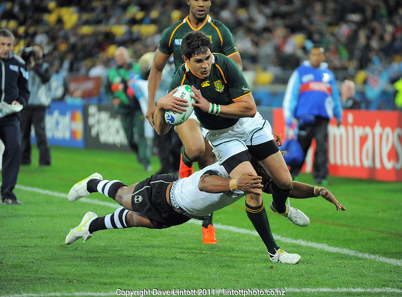 Jaque Fourie scores for the Springboks during the South Africa versus Fiji pool D match of the 2011 IRB Rugby World Cup at Wellington Regional Stadium, Wellington, New Zealand on Saturday, 17 September 2011. Photo: Dave Lintott / lintottphoto.co.nz