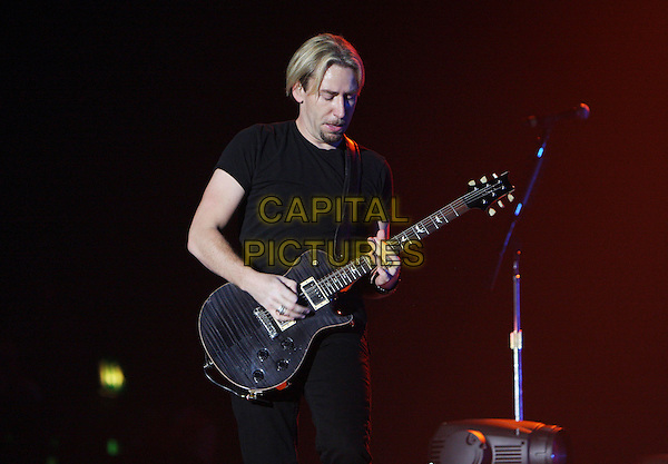 NICKELBACK  - Chad Kroeger.Perform live in concert at Wembley Arena, London, England, UK,.19th January 2010..music gig band tour on stage playing performing guitar group half length black t-shirt cuff bracelet looking down ring .CAP/MAR.© Martin Harris/Capital Pictures.