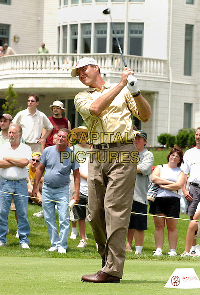 MARIO LEMIEUX .(NHL - Pittsburgh Penguin Superstar).participated at the 2004 Mellon Mario Lemieux Celebrity Invitational at The Club At Nevillewood,  Pittsburgh, PA, USA, June 10-13 2004..full length playing club sport cap hat golf .Ref: ADM.www.capitalpictures.com.sales@capitalpictures.com.©Jason Nelson/AdMedia/Capital Pictures.