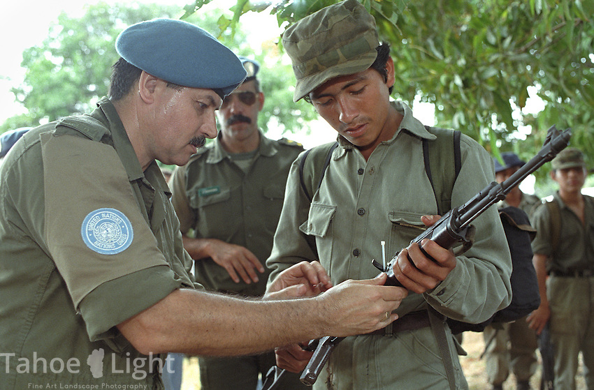 Guatemalan URNG rebel troops, right, hand over their arms to United Nations peace keepers as part of a peace agreement reached in December, 1996, which ended 36 years of civil war in the country.