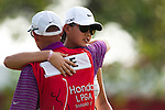 CHON BURI, THAILAND - FEBRUARY 19:  Michelle Wie of USA embraces her caddie Brendan Woolley on the 18th green during day three of the LPGA Thailand at Siam Country Club on February 19, 2011 in Chon Buri, Thailand. Photo by Victor Fraile / The Power of Sport Images