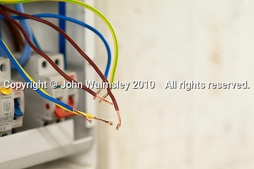 Student electrician install wiring in a fusebox, Able Skills, Dartford, Kent.