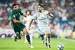Isco Alarcon (r) of Real Madrid is tackled by Antonio Barragan Fernandez of Real Betis during the La Liga 2017-18 match between Real Madrid and Real Betis at Estadio Santiago Bernabeu on 20 September 2017 in Madrid, Spain. Photo by Diego Gonzalez / Power Sport Images
