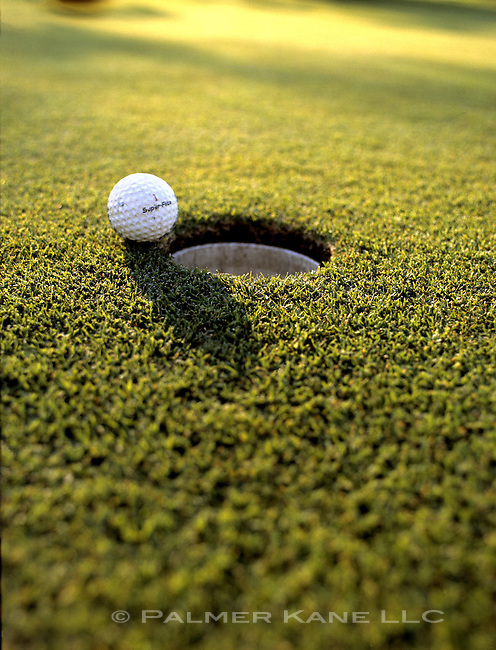 Golfball on the edge of a hole. Cerramar Beach Resort, Puerto Rico
