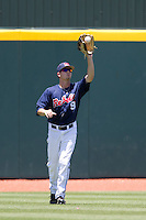 Outfielder Auston Bousfield #9 of the Ole Miss Rebels makes a catch during the NCAA Regional baseball game against the Texas Christian University Horned Frogs on June 1, 2012 at Blue Bell Park in College Station, Texas. Ole Miss defeated TCU 6-2. (Andrew Woolley/Four Seam Images).