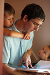 My husband reads a Bible story to our sons as we begin our day.