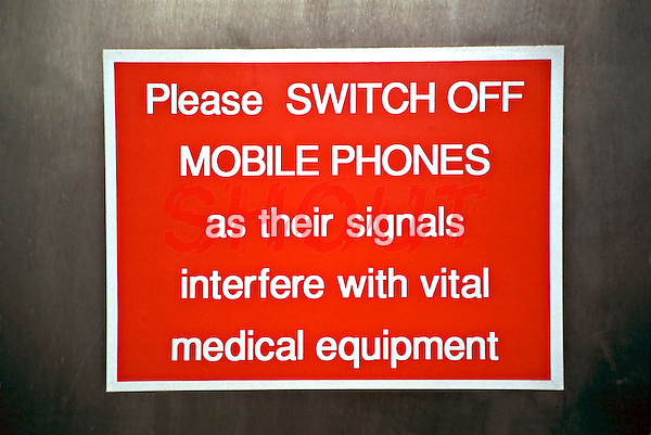 Please turn off your mobile phone before entering the hospital sign. This sign is placed at the entrance to the hospital in an attempt to stop mobile telephones from being used and interfering with medical equipment.