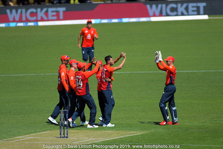 England's Saqib Mahmood celebrates dismissing Tim Seifert. Twenty20 International cricket match between NZ Black Caps and England at Westpac Stadium in Wellington, New Zealand on Sunday, 3 November 2019. Photo: Dave Lintott / lintottphoto.co.nz