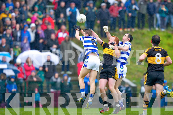 Johnny Buckley is stuck between  Castlehaven's Sean Dineen and Dermot Hurley during their Munster Club Championship QF in Lewis Road on Sunday