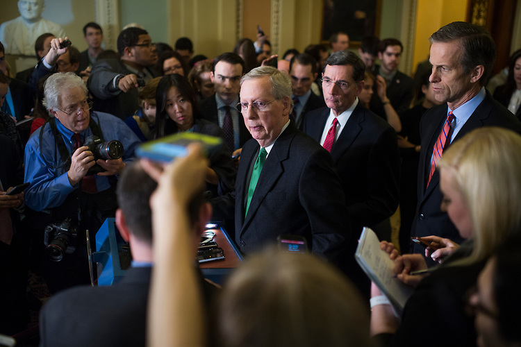 UNITED STATES - MARCH 7: Senate Majority Leader Mitch McConnell, R-Ky., conducts a news conference Sens. John Barrasso, R-Wyo., John Thune, R-S.D., right, after the Senate Policy luncheons in the Capitol where he made remarks on the House Republican's new healthcare plan, March 7, 2017. Vice President Mike Pence also made remarks. (Photo By Tom Williams/CQ Roll Call)