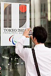 A man takes a picture of the Tokyo 2020 Paralympic Games logo at the entrance of Tokyo Metropolitan building on September 1, 2015, Tokyo, Japan. The Tokyo Olympic organizers have decided to drop the logo for the 2020 Games after an emergency meeting on Tuesday September 1st. Designer Kenjiro Sano's logo had been critized after Belgian, Olivier Debie, instigated legal action due to similarities to his logo for the Theater de Liege in Belgium. Beleaguered Sano has also recently faced other questions of plagiarism over his past designs. (Photo by Rodrigo Reyes Marin/AFLO)