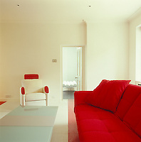 In the dressing room the sofa and armchair are by Ligne Roset and red and white ridged rubber floors are by Dalsouple