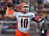 Dominic Rutigliano #10, Carey quarterback, throws on the run for a completion during a Nassau County Conference II varsity football game against host Garden City High School on Saturday, Oct. 14, 2017.