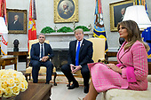 US President Donald J. Trump (C) and President of Colombia Ivan Duque (L) meet beside US First Lady Melania Trump (R) in the Oval Office of the White House in Washington, DC, USA, 13 February 2019. President Trump and President Duque are meeting to discuss economic policies, combatting narcotics and the current situation in Venezuela.<br /> Credit: Michael Reynolds / Pool via CNP