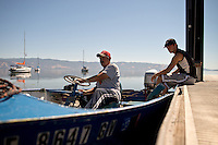 Commercial fisherman Brian Jourdain, left, and his son, Joey, prepare their 1957 Lone Star boat at the Third Street Boat Launch on Clear Lake, in Lakeport, Calif., on July 12, 2013. (Alvin Jornada / For The Press Democrat)