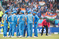 Indian players together following the dismissal of Nicholls during India vs New Zealand, ICC World Cup Semi-Final Cricket at Old Trafford on 9th July 2019