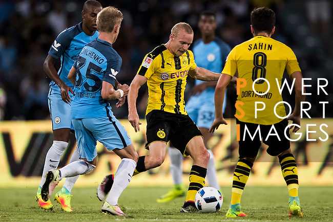 Borussia Dortmund midfielder Sebastian Rode (c) fights for the ball with Manchester City midfielder Fernandinho Roza (l) during the match against Manchester City FC at the 2016 International Champions Cup China match at the Shenzhen Stadium on 28 July 2016 in Shenzhen, China. Photo by Victor Fraile / Power Sport Images
