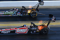 Sep 13, 2014; Concord, NC, USA; NHRA top fuel driver Leah Pritchett (near) races alongside Brittany Force during qualifying for the Carolina Nationals at zMax Dragway. Mandatory Credit: Mark J. Rebilas-USA TODAY Sports