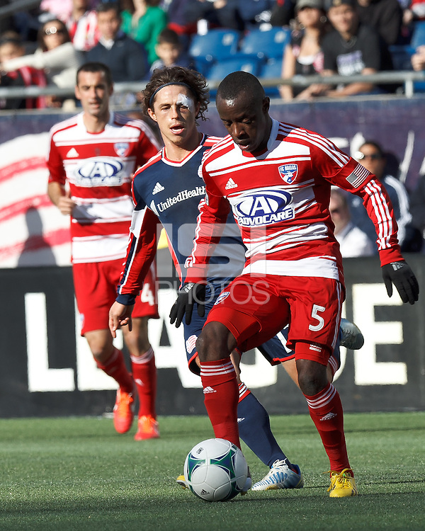 First half action:.FC Dallas defender Jair Benitez (5) dribbles as New England Revolution midfielder Ryan Guy (13) defends..  In a Major League Soccer (MLS) match, the New England Revolution (blue) vs FC Dallas (red), at Gillette Stadium on March 30, 2013.