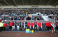 Pictured: The Swansea bench observe a minute's silence  before kick off in memory of Wales football manager Gary Speed who has died. Saturday 27 November 2011<br />