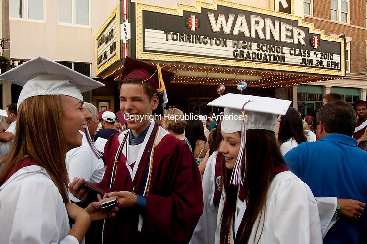 TORRINGTON, CT 20 JUNE, 2010-062010JS01-Torrington High School graduates Rebecca Waldron, Chris Roys and April Rollett share a laugh outside the Warner Theatre in Torrington following graduation ceremonieson Sunday.<br /> Jim Shannon Republican-American
