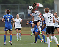 Portland Thorns FC midfielder Meleana Shim (6) heads the ball.  In a National Women's Soccer League (NWSL) match, Portland Thorns FC (white) defeated Boston Breakers (blue), 2-1, at Dilboy Stadium on July 21, 2013.