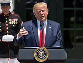 """United States President Donald J. Trump makes remarks as he hosts the Third Annual """"Made in America"""" Product Showcase on the South Lawn of the White House in Washington, DC on Monday, July 15, 2019. The President also took questions from the media.<br /> Credit: Ron Sachs / CNP"""