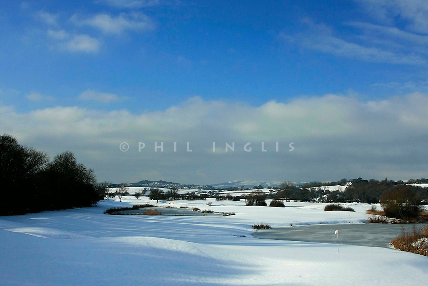 A general view of the snow covered 14th green at the Twenty Ten Course, The Celtic Manor Resort, Wales during one of the coldest winters on record in the UK....