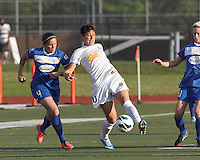 Western New York Flash forward Abby Wambach (20) passes the ball as Boston Breakers defender Cat Whitehill (4) closes. In a National Women's Soccer League Elite (NWSL) match, the Boston Breakers (blue) tied Western New York Flash (white), 2-2, at Dilboy Stadium on June 5, 2013.