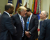 """United States President Donald Trump meets with representatives from PhRMA, the Pharmaceutical Research and Manufacturers of America in the in the Oval Office Roosevelt Room of the White House in Washington, DC on Tuesday, January 31, 2017.  According to its website PhRMA """"represents the country's leading biopharmaceutical researchers and biotechnology companies."""" <br /> Credit: Ron Sachs / Pool via CNP"""