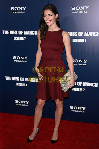 "Hilary Rhoda.The New York Premiere of ""The Ides of March"" at the Ziegfeld Theater, New York, NY, USA..October 5th, 2011.full length red maroon burgundy sleeveless dress grey gray snakeskin clutch bag.CAP/LNC/TOM.©TOM/LNC/Capital Pictures."