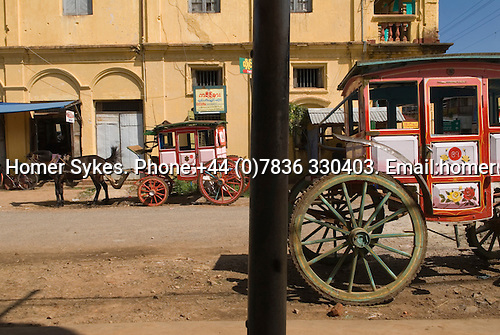 Horse and miniature stage coaches built by the British in the 19th century and still used for everyday transport. Pyin U Lwin Myanmar (formally known as Maymyo Burma.) 2006