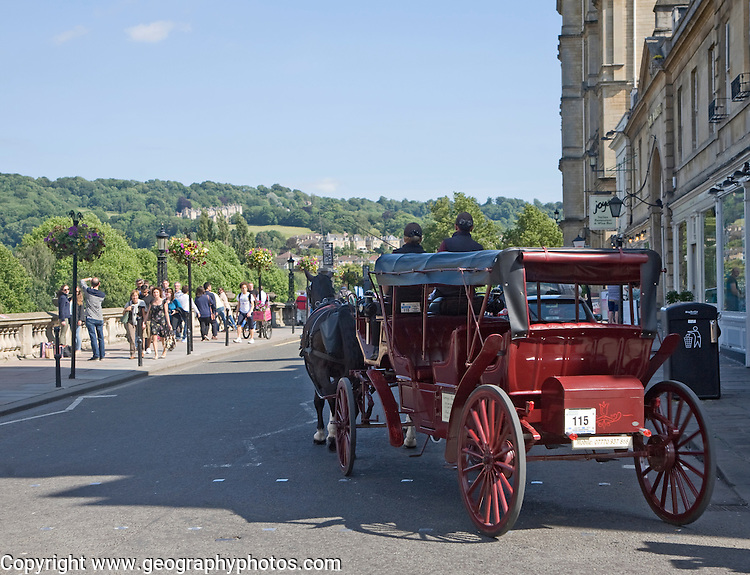 Horse drawn carriage tourist ride on Grand Parade, Bath, Somerset, England