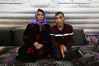 &quot;We have been living here in Lebanon for 4 years now&quot;, says Um Ali. &quot;We get a little bit of work and try to support ourselves&quot;.<br /> <br /> &quot;We been receiving $260 a month in cash and food vouchers support. We are just about managing. We are very grateful, to Britain and others. <br /> <br /> &quot;All of us fled war in Syria. We lost everything and came here to Lebanon. The financial support is hardly enough. I get bread on credit, from one month to the next. <br /> <br /> &quot;We are displaced. We are tired because of work, mud and puddles.<br /> <br /> &quot;The door is broken and the tent leaks. Our clothes get wet because of the leak. There is just one layer of insulation on the outside, nylon. On the inside they applied this sliver layer this year to try and make it a bit warmer, but I couldn&rsquo;t even buy even a tarpaulin sheet for the outside. I don&rsquo;t have enough money.<br /> <br /> &quot;I hope the situation will calm down, and we are able to go back home rather than remain displaced.<br /> <br /> &quot;We would love to go back to our homes and homeland. If it wasn&rsquo;t for the little bit of work that we are able to get and the cash support that we are trying to manage with, our life would be truly dire.&quot;