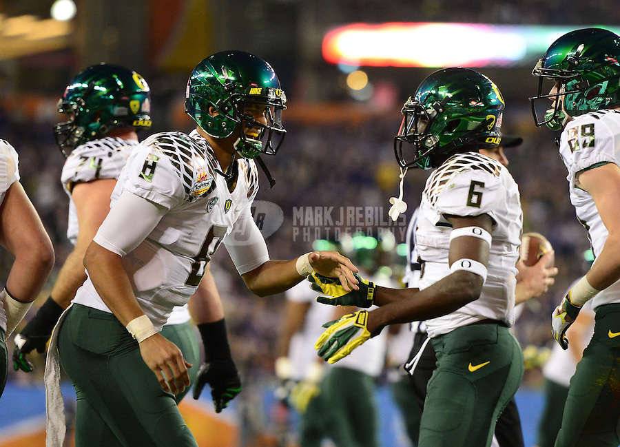 Jan. 3, 2013; Glendale, AZ, USA: Oregon Ducks running back De'Anthony Thomas (6) is congratulated by quarterback Marcus Mariota (8) after running for a touchdown in the first quarter against the Kansas State Wildcats during the 2013 Fiesta Bowl at University of Phoenix Stadium. Mandatory Credit: Mark J. Rebilas-