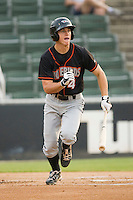Mikey Planeta #4 of the Delmarva Shorebirds hustles down the first base line against the Kannapolis Intimidators at Fieldcrest Cannon Stadium May 14, 2010, in Kannapolis, North Carolina.  Photo by Brian Westerholt / Four Seam Images