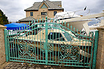 BROAD CHANNEL, NEW YORK-NOVEMBER 01: Boats from the North Channel Yacht Club fill the front yard of a home after Hurricane Sandy November 1, 2012. in Queens. The super storm has caused over 20 billion USD in damages.
