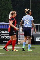 Rochester, NY - Saturday May 21, 2016: Western New York Flash midfielder Abigail Dahlkemper (13) and Sky Blue FC forward Tasha Kai (32) showing the bandages on Kai's hand. The Western New York Flash defeated Sky Blue FC 5-2 during a regular season National Women's Soccer League (NWSL) match at Sahlen's Stadium.