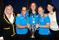 High Wycombe, England. Wasps' Rugby World Cup winning ladies Claire Purdy, Joanna McGilchrist, La Toya Mason with the World Cup trophy at the Aviva Premiership match between Wasps and Northampton Saints at Adams Park on September 14, 2014 in High Wycombe, England.